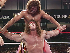 Arguably one of Rude's most memorable feuds in the WWF was with the late Ultimate Warrior. photo: wwe.com