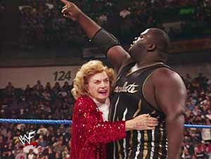 "In one of the more ridiculous angles in WWF's ""Attitude Era"" - Mark Henry finds a love interest in the 80 year old Mae. photo: wwe.com"