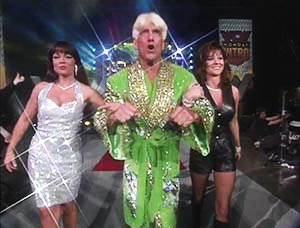 Nancy (left) escorts Ric Flair to the ring along with Elizabeth. photo: wwe.com