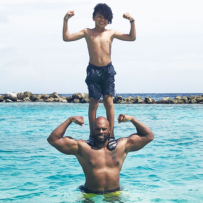 shad gaspard and his son at the beach